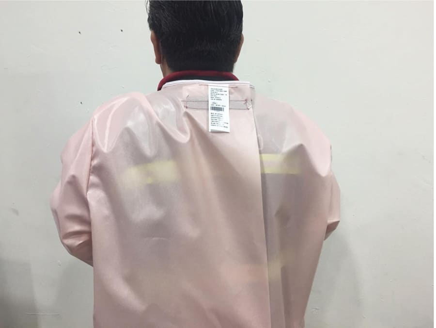 back view of isolation gown with label shown
